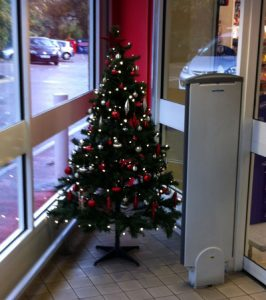 A Christmas Tree in the foyer of a supermarket
