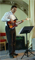 Playing bass for a wedding in St. Luke's